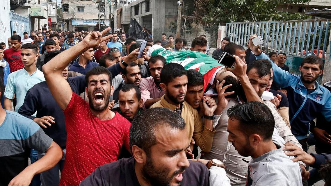 Mourners carry the body of 19-year-old Palestinian Nassar Abu Taim, who was killed the day before amid clashes following a protest at the Israel-Gaza border fence, during his funeral in Khan Yunis in the southern Gaza Strip on October 27, 2018. SAID KHATIB / AFP