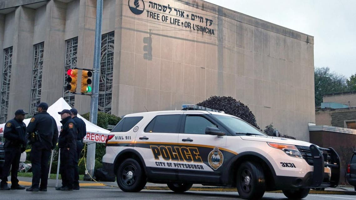 Police officers guard the Tree of Life synagogue following shooting at the synagogue in Pittsburgh, Pennsylvania. (Reuters)
