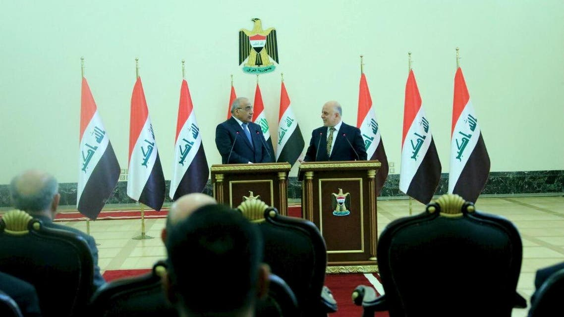 Iraq's Prime Minister-designate Adel Abdul Mahdi speaks with former Prime Minister Haidar al-Abadi during the office handover ceremony in Baghdad, Iraq, October 25, 2018. (Reuters)