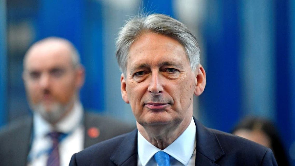Britain's Chancellor of the Exchequer Philip Hammond arrives at the ICC for the third day of the Conservative Party Conference in Birmingham. (Reuters)