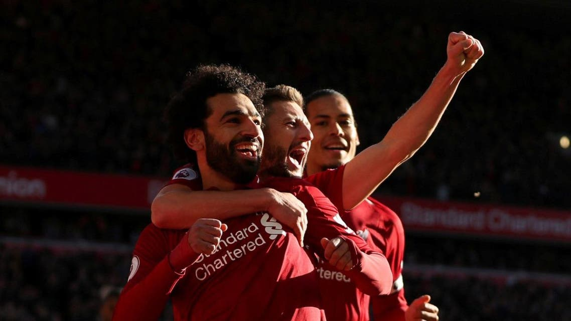 Liverpool's Mohamed Salah celebrates scoring their first goal with Adam Lallana and Virgil van Dijk Action. (Reuters/Lee Smith)