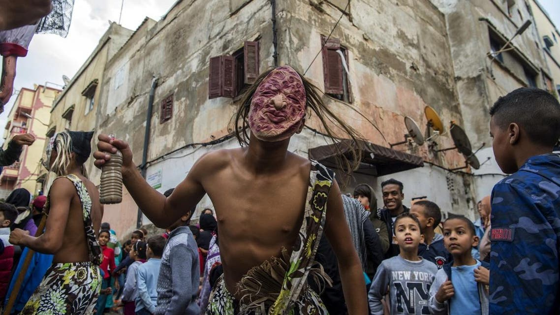Young Moroccans take part in the Boujloud festival, a popular festival also known as the 'Moroccan Halloween' in the Sidi Moussa district of Sale near Rabat. (AFP)