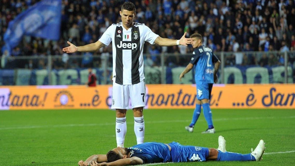 Juventus' Cristiano Ronaldo reacts after Empoli's Matias Silvestre goes down. (Reuters)
