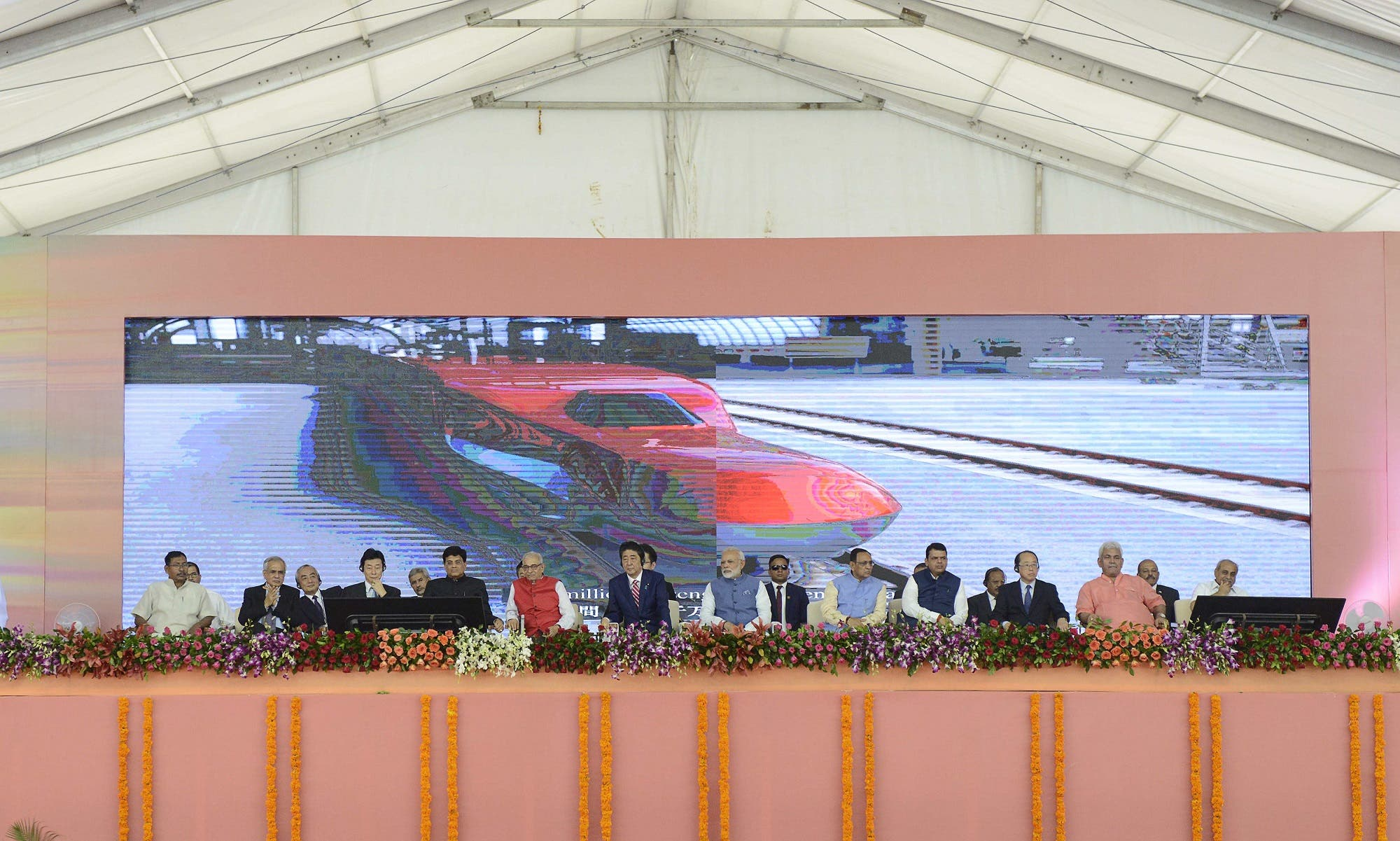 Prime Minister Narendra Modi (7L) and Japanese Prime Minister Shinzo Abe (6L) during ground breaking ceremony for the high speed rail project in Ahmedabad on September 14, 2017. (AFP)