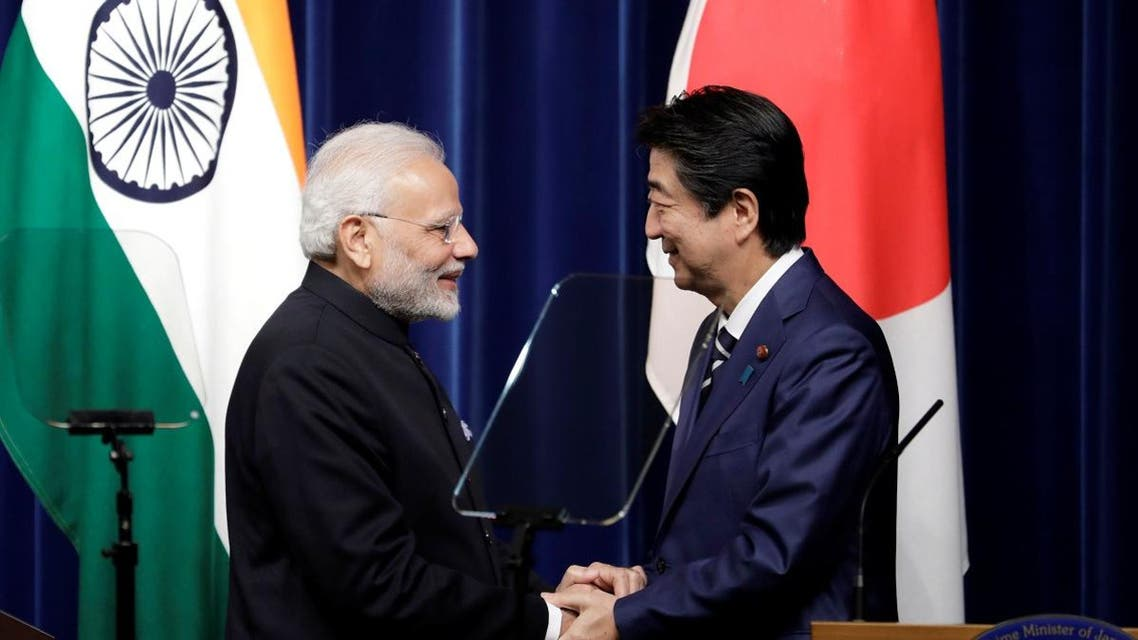 Narendra Modi, India's prime minister and Shinzo Abe, Japan's prime minister, shake hands during a joint news conference. (Reuters)