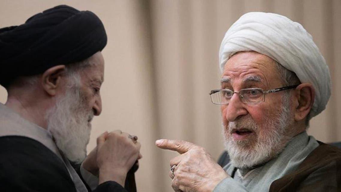 يزدي (يمين) انتقد زنجاني بسبب صورة مع خاتمي