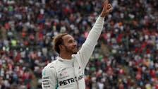 Britain's Hamilton celebrates fifth F1 title as Verstappen wins in Mexico