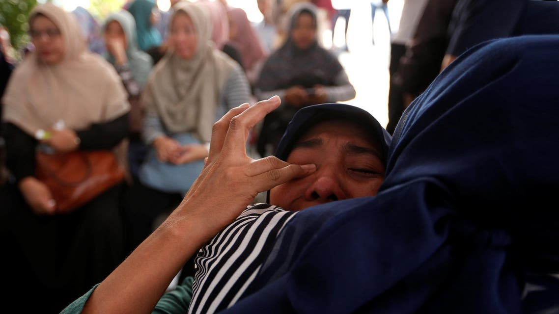 A woman, who is family of passengers on the crashed Lion Air flight JT610, cries at Bhayangkara R. Said Sukanto hospital in Jakarta. (Reuters)