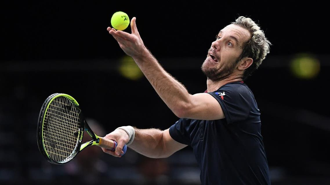 France's Richard Gasquet serves the ball to Canada's Denis Shapovalov during their men's singles first round tennis match on day one of the ATP World Tour Masters 1000 - Rolex Paris Masters  on October 29, 2018. (AFP)