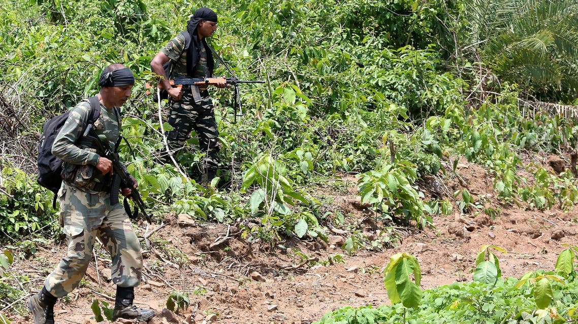 Military personnel patrolling in a forest in operations against Maoist rebels in West Singhbhum district of Jharkhand on May 9, 2018. (AFP)