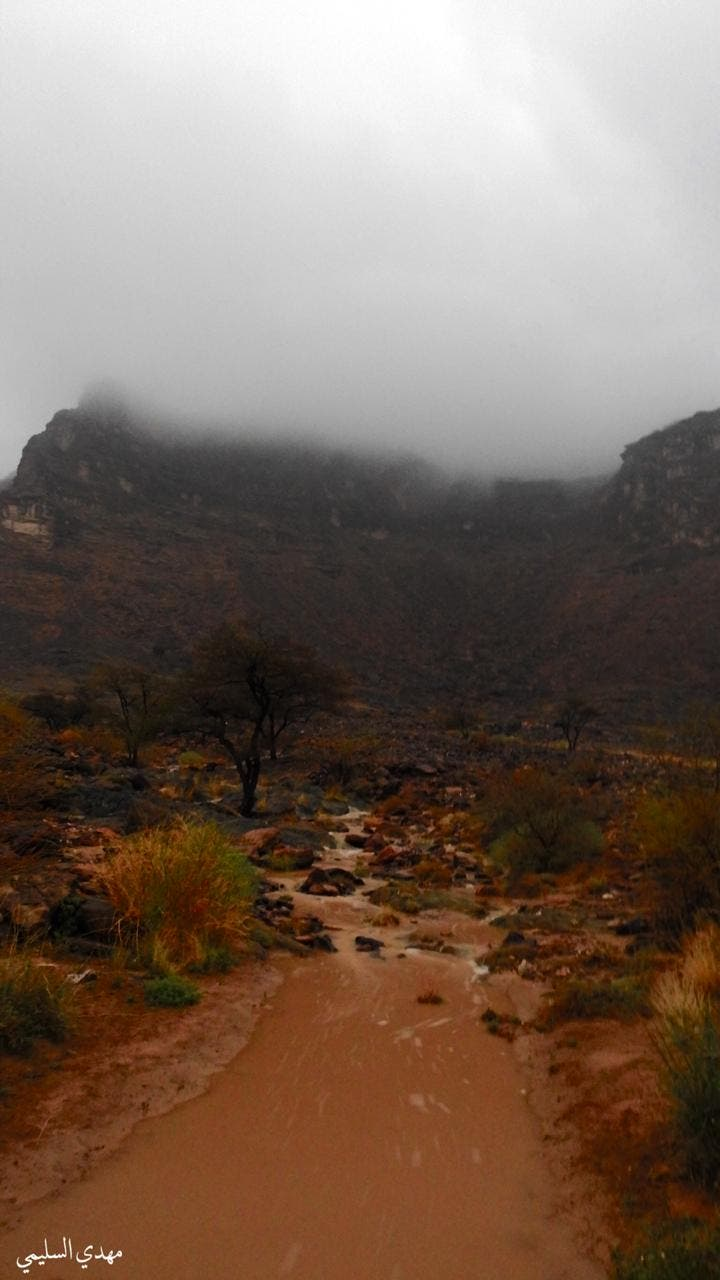 Rainfall over Saudi Arabia's Najran: Foggy mountaintops and flooded valleys