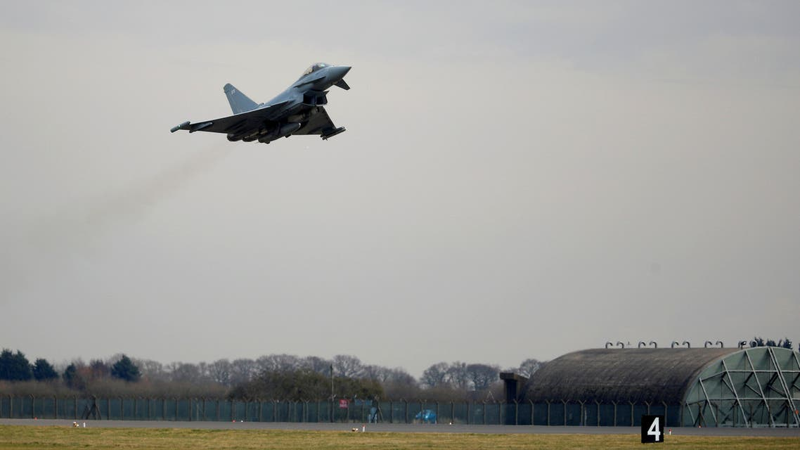 An RAF Typhoon jet takes off during a visit by Britain's Prince William, Duke of Cambridge to RAF Coningsby in Lincolnshire on March 7, 2018.