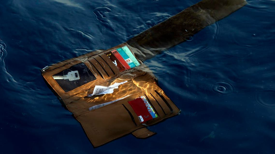 A wallet belonging to a victim of the Lion Air passenger jet that crashed floats in the waters of Ujung Karawang, West Java, Indonesia. (AP)