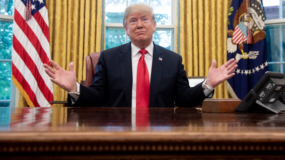 (FILES) In this file photo taken on October 10, 2018 US President Donald Trump speaks during a briefing on Hurricane Michael in the Oval Office of the White House in Washington, DC. President Donald Trump kept up the pressure on Mexico October 31, 2018 to halt groups of migrants heading to the American border, as the US enters the final stretch of campaigning before key midterm elections. Trump has sought to put immigration front and center ahead of next week's hotly-contested vote, ordering thousands of troops to the southern border and threatening to end automatic citizenship for US-born children of immigrants.