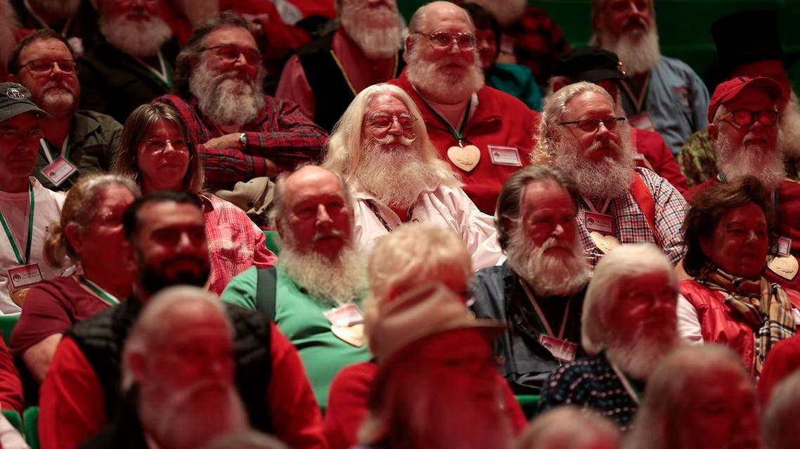 Participants at Santa School pose for a group photo in Midland, Michigan. (Reuters)