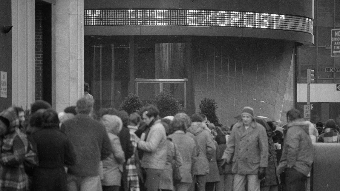 "Despite sub-freezing temperatures and rain, a crowd waits in line outside the Paramount Theater in New York City February 4, 1974 for a showing of ""The Exorcist."" (AP)a"