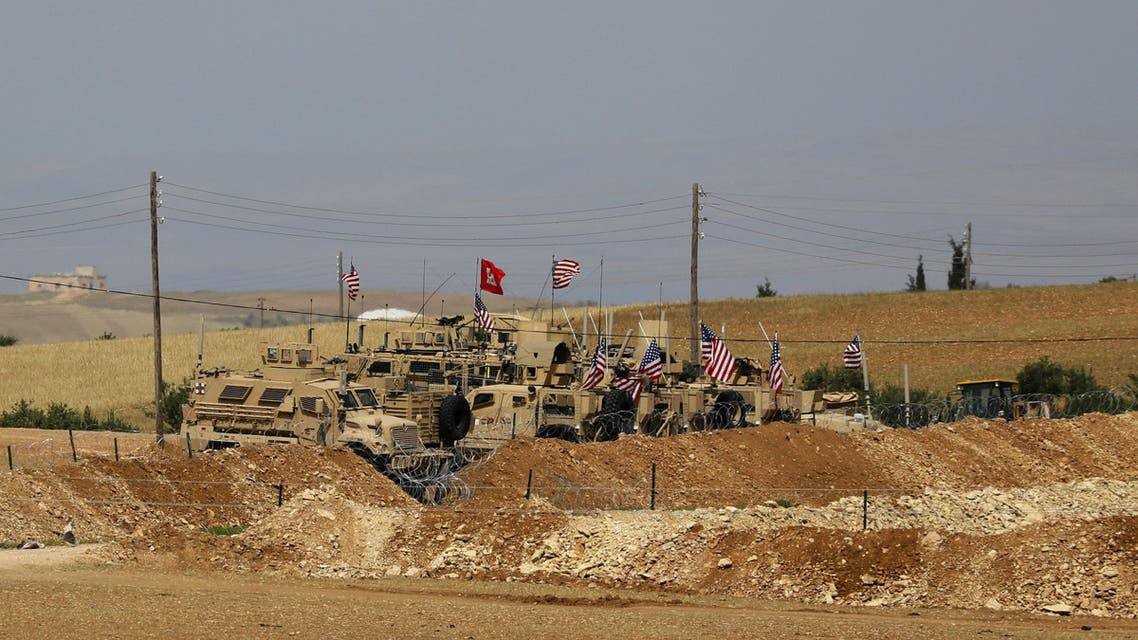 A picture taken on May 8, 2018 shows vehicles of the US-backed coalition forces in the northern Syrian town of Manbij. The Syrian Observatory for Human Rights, a Britain-based monitor with sources on the ground, says around 350 members of the US-led coalition -- mostly American troops -- are stationed around Manbij.