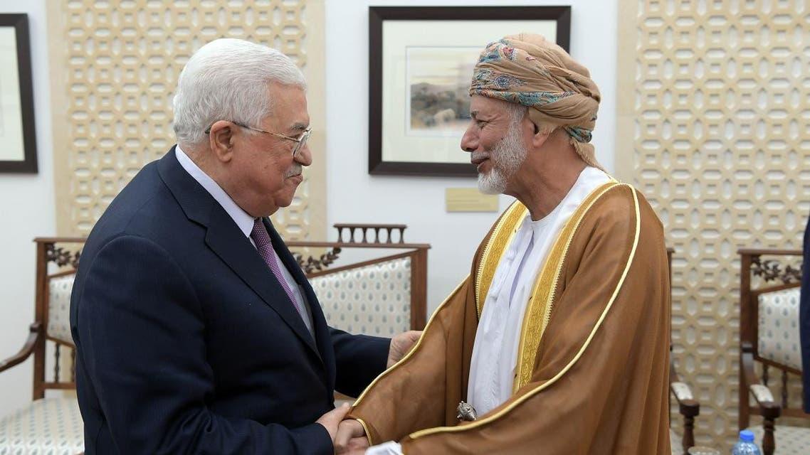 Omani minister Yusuf al-Alawi and Mahmoud Abbas. (AFP)