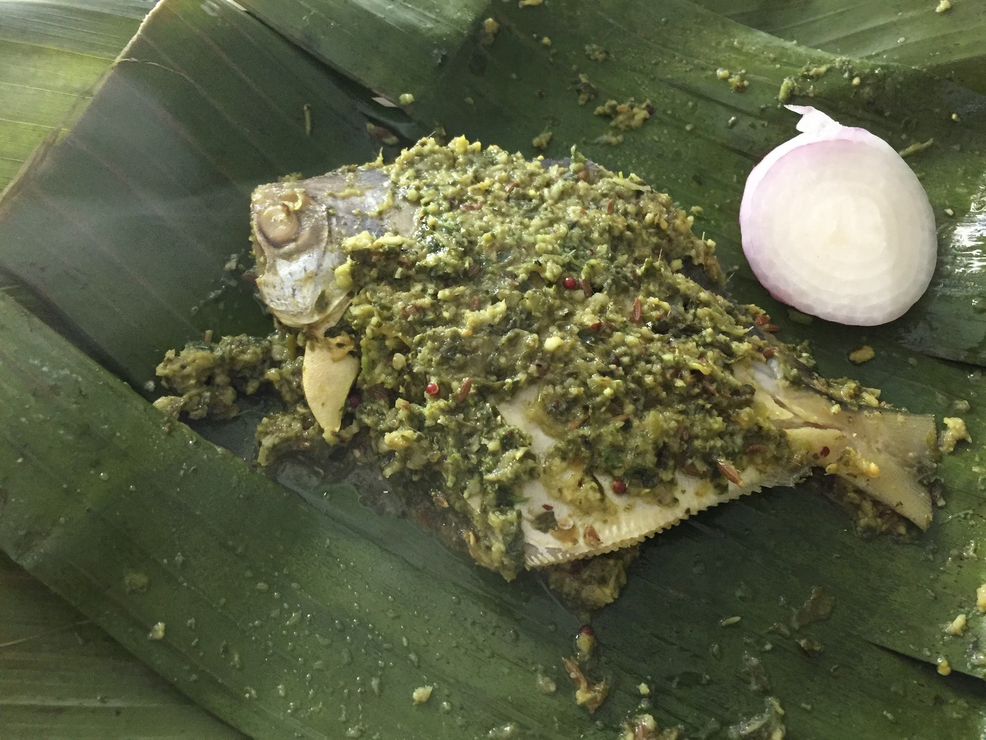 These leaf-wrapped seafood dishes vary from region to region and are usually prepared using the locally available spices and fishes. (Supplied)