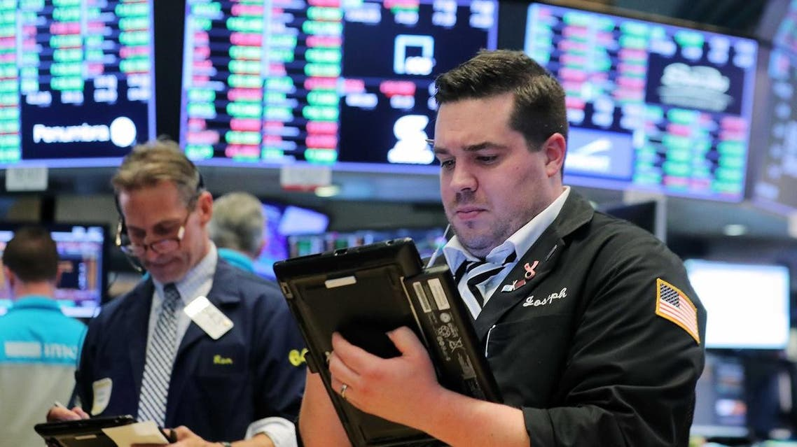 Traders work on the floor of the New York Stock Exchange (NYSE) near the close of market in New York. (Reuters)