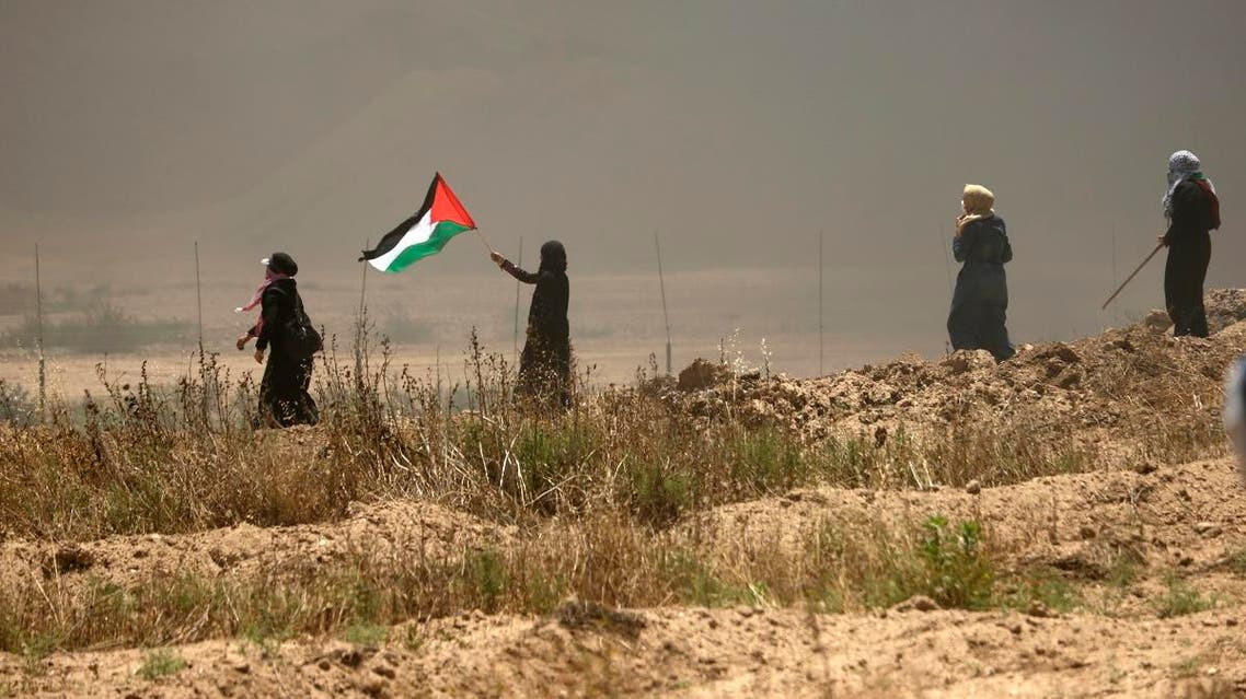 A Palestinian women waves her national flag (AFP)
