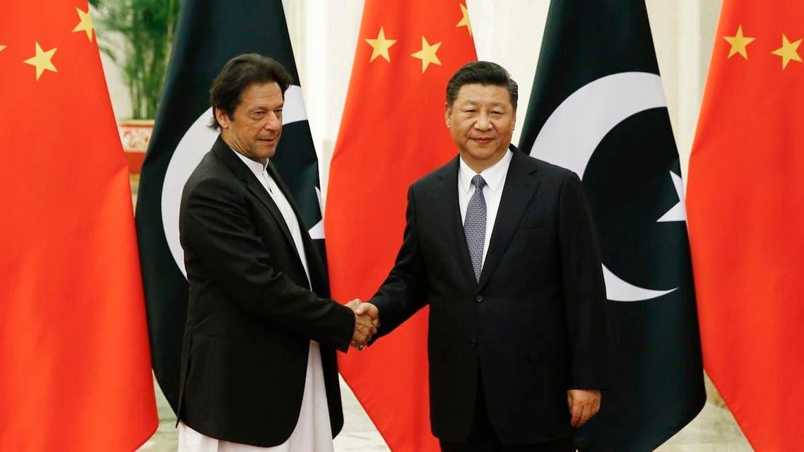 Imran Khan and Xi Jinping. (AP