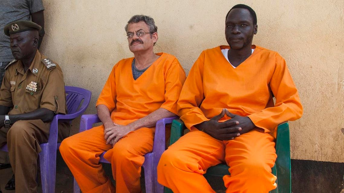 Endley (C) and Gatdet sit inside the prison before their release on November 2, 2018 in Juba. (AFP)