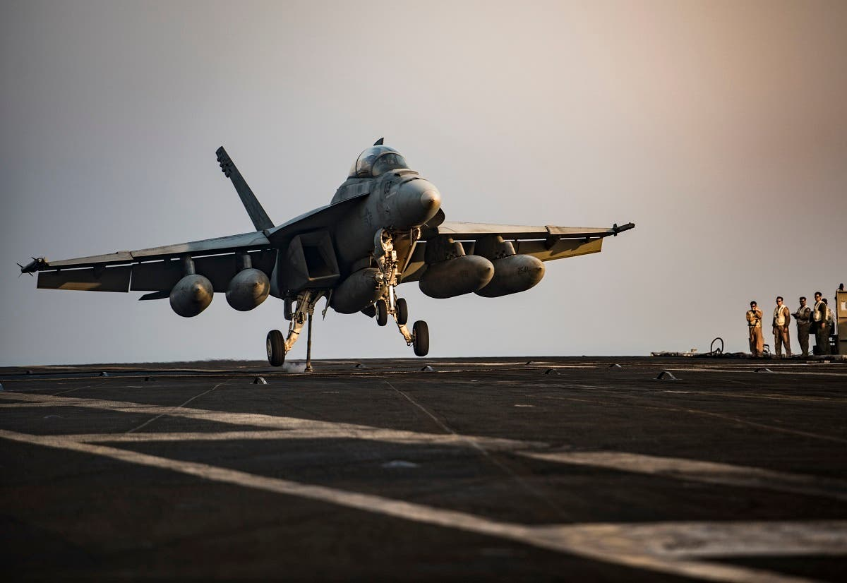 An F/A-18F Super Hornet preparing to make an arrested landing on the flight deck of the aircraft carrier USS Dwight D. Eisenhower (CVN 69) (Ike) in the Arabian Gulf. (File photo: AFP)