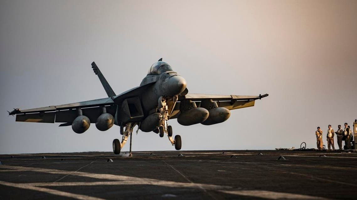 US Navy handout photo shows an F/A-18F Super Hornet preparing to make an arrested landing on the flight deck of the aircraft carrier USS Dwight D. Eisenhower (CVN 69) (Ike) in the Arabian Gulf after a mission in support of Operation Inherent Resolve. (AFP)