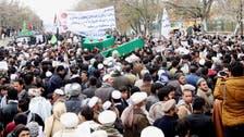 Afghan Shiite militia battles Taliban, raising sectarian fears
