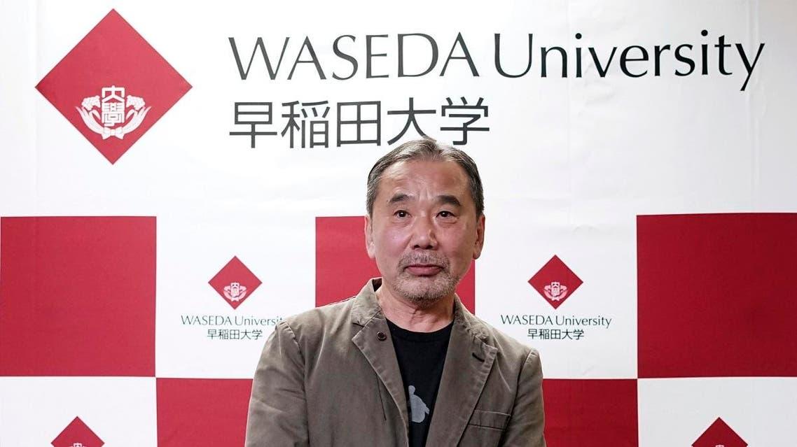 Japanese novelist Haruki Murakami poses for photographers during a press conference at Waseda University in Tokyo. (AP)