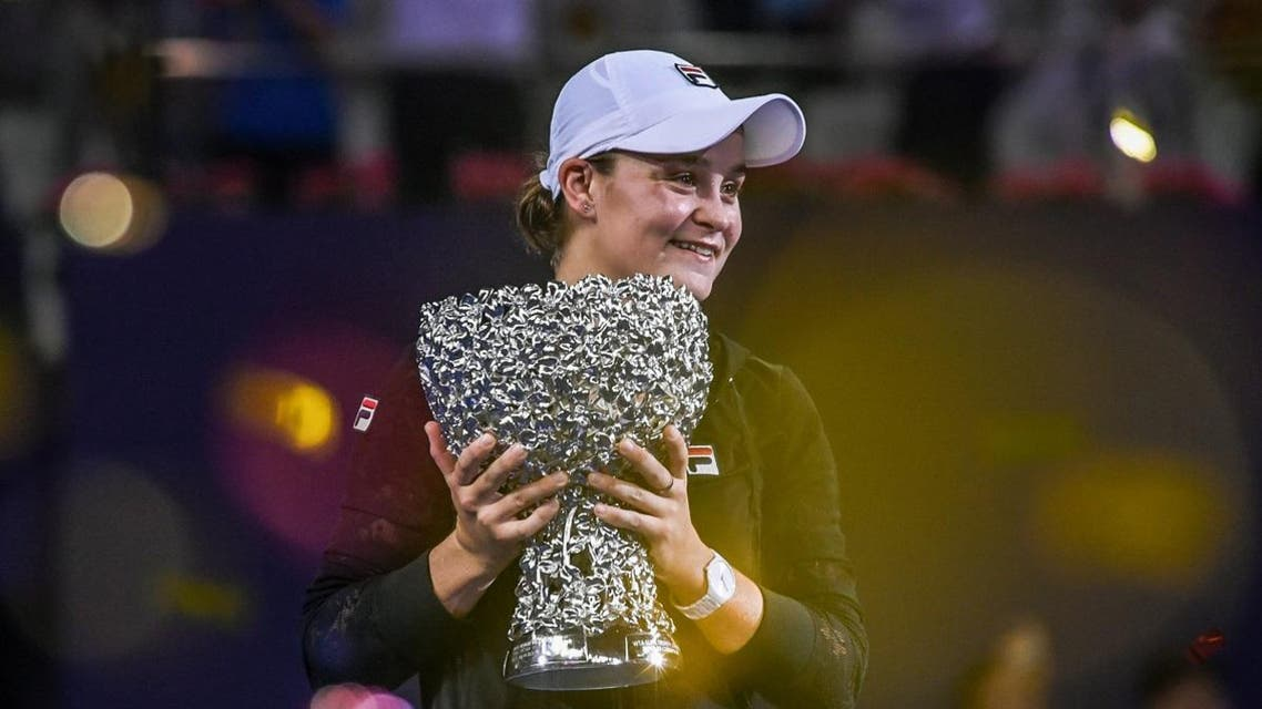 Ashleigh Barty of Australia holds the trophy after winning the women's singles final match against Wang Qiang of China at the Zhuhai Elite Trophy tennis tournament in Zhuhai. (AFP)