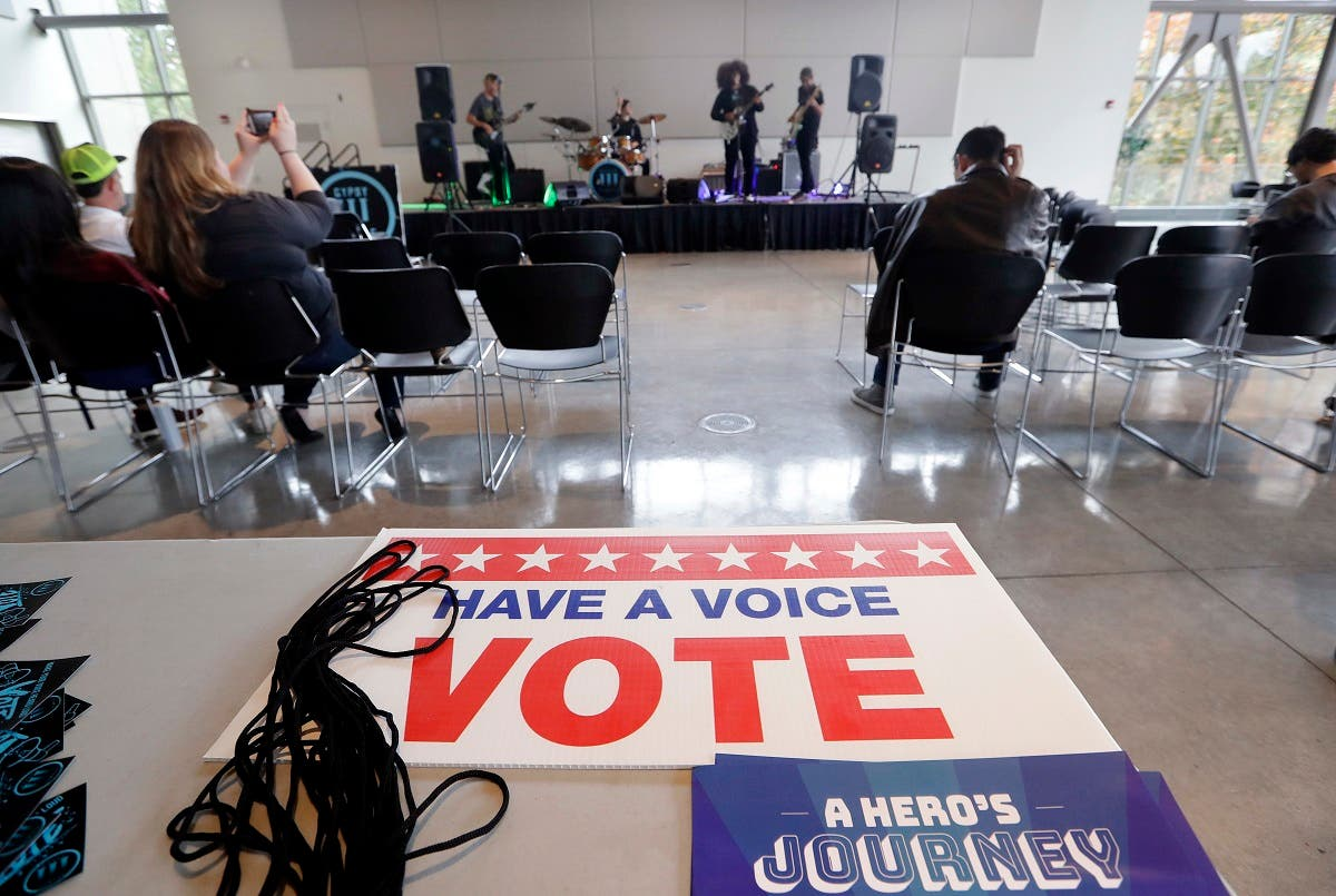 A small crowd watches the band Gypsy Temple during a performance by the group urging youth to participate in the November election at Shoreline Community College. (AP)