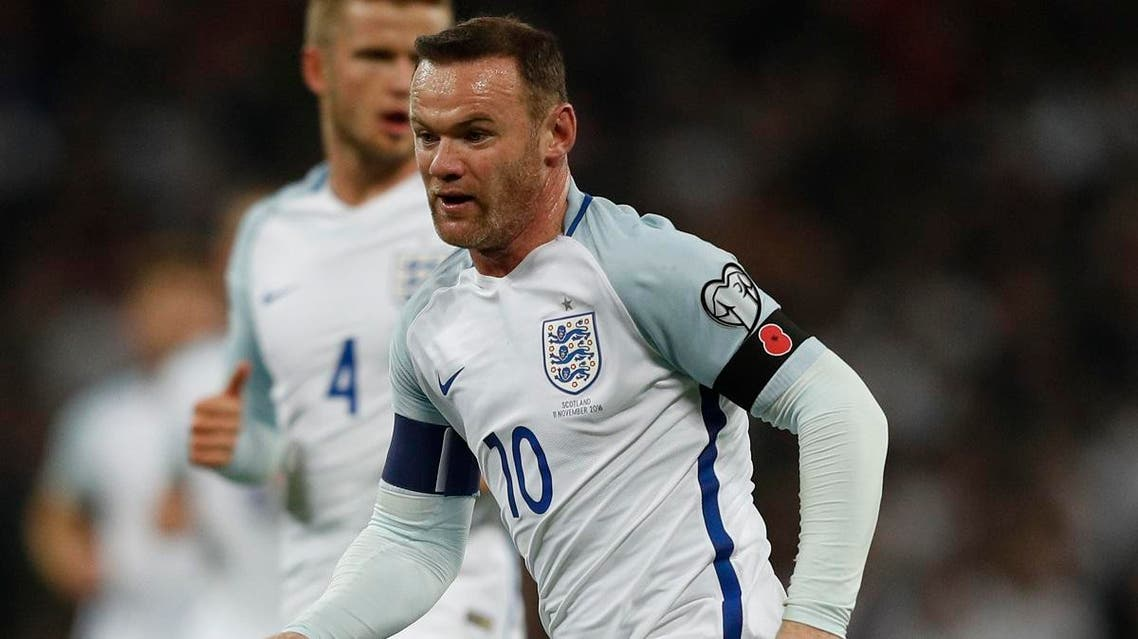 Wayne Rooney wears a poppy armband to commemorate Armistice Day as he plays during a World Cup qualification match. (File photo: AFP)
