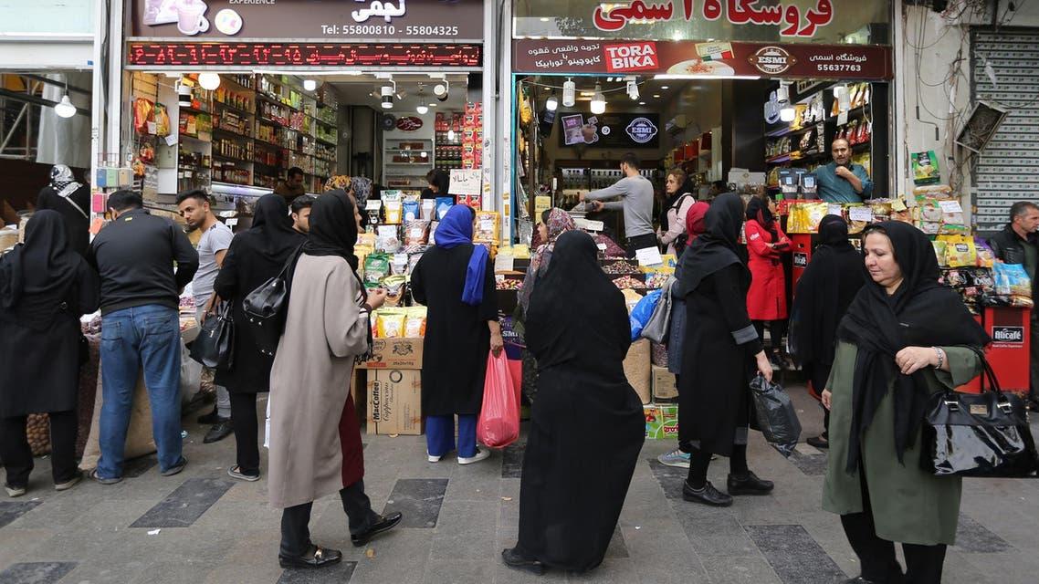 Iranians shop at the grand bazar in Tehran on November 3, 2018. (AFP)
