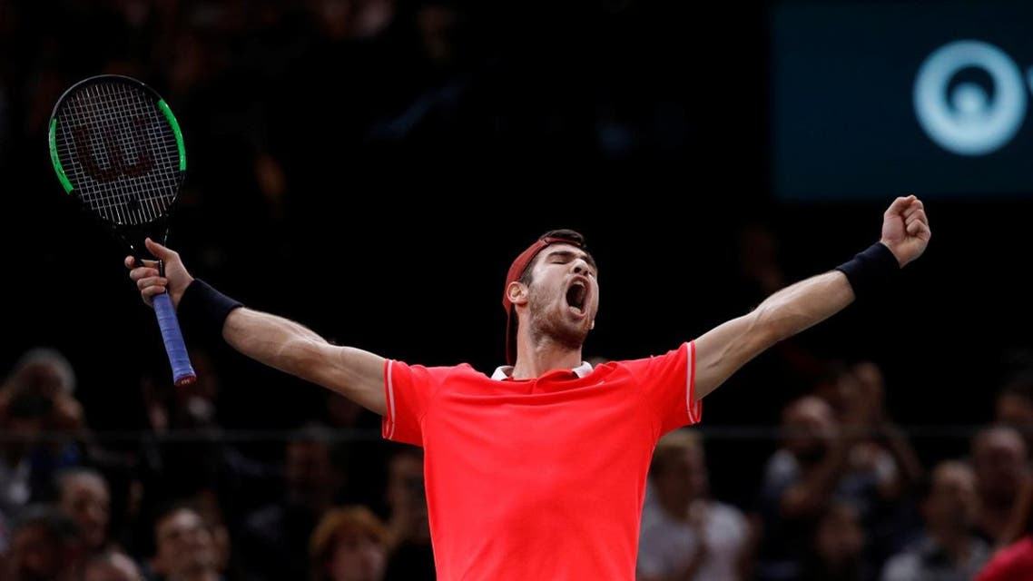 Russia's Karen Khachanov celebrates after winning the final against Serbia's Novak Djokovic. (Reuters)