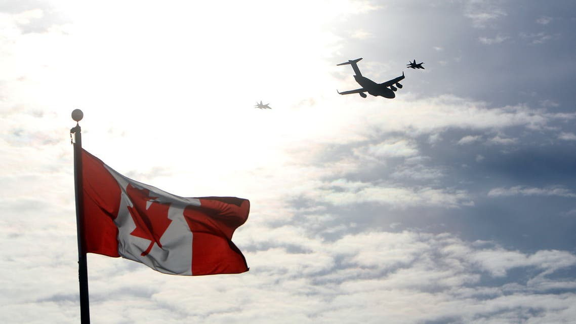 The plane carrying the last of Canada's troops in Afghanistan is escorted through the air by fighter jets, after the last Canadian troops from Afghanistan returned to Ottawa International Airport on March 18, 2014 in Ottawa, Ontario. Eighty-four armed forces members were welcomed home marking the end of Canada's participation in the Afghanistan war, a mission that spanned 12 years. AFP PHOTO/ Cole Burston