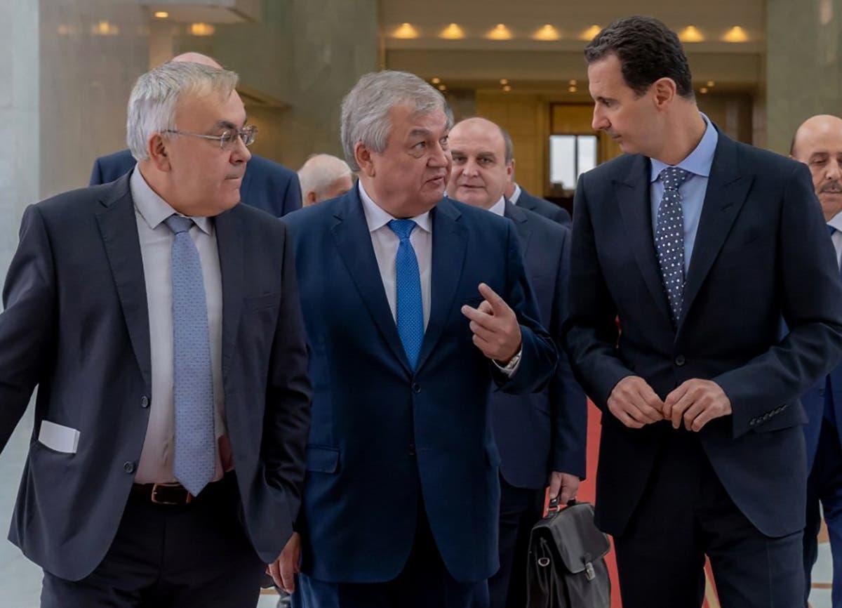 Syrian President Basah al-Assad (R) receiving Russian special envoy to Syria Alexander Lavrentiev (C) (AFP)