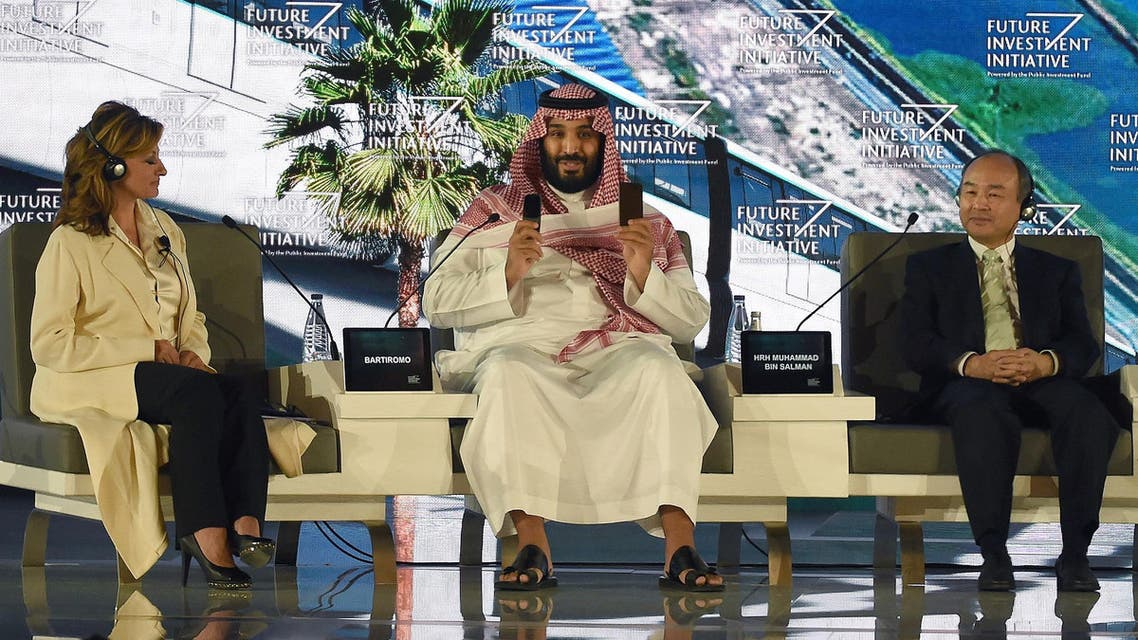 Saudi Crown Prince Mohammed bin Salman (C) and Masayoshi Son, CEO of SoftBank, attend the Future Investment Initiative conference in Riyadh, on October 24, 2017. (AFP)