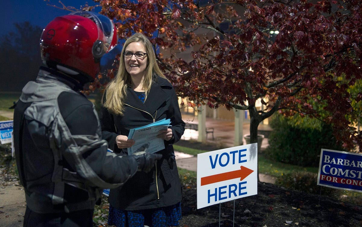 Virginia Democratic congressional candidate Jennifer Wexton, a former prosecutor and current Democratic state senator, greets voters at Ida Lee Park on, Tuesday, Nov. 6, 2018 in Leesburg, Va. (AP)
