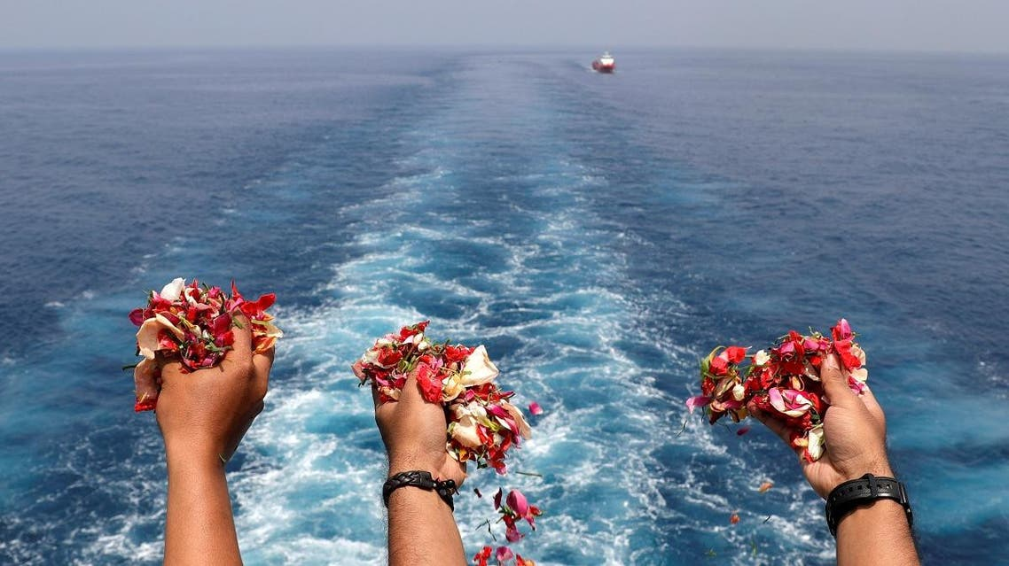 Families and colleagues of passengers and crew of Lion Air flight JT610 throw flowers and petals from the deck of Indonesia Navy ship KRI Banjarmasin as they visit the site of the crash to pay their tribute, at the north coast of Karawang. (Reuters)