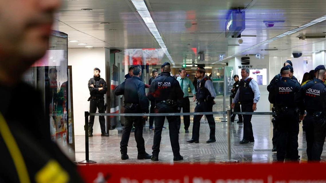 Mossos d'Esquadra regional police in Catalonia cordon off one of the entrance at the city's main train station in Barcelona, Spain, on Wednesday, November 7, 2018. (AP)