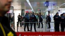 Grenade-shaped belt buckle halts trains in Madrid, Barcelona