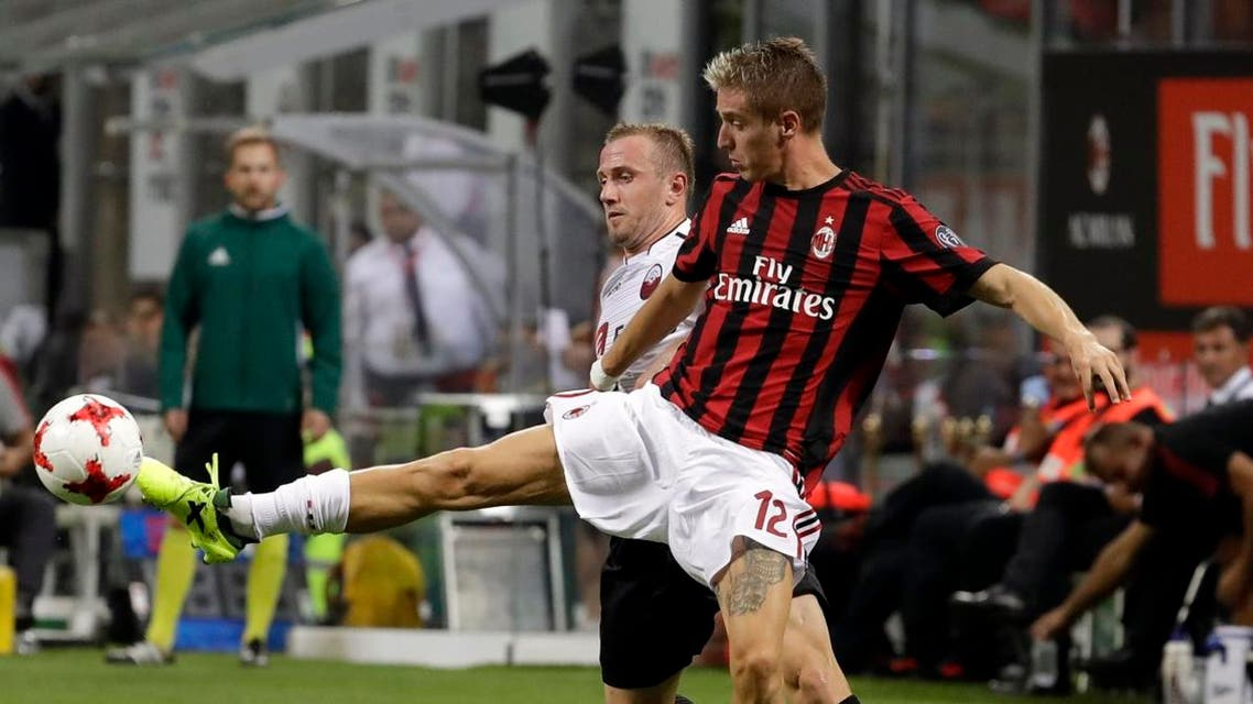 AC Milan's Andrea Conti, right, and Shkendija's Ivan Celikovic vie for the ball during the Europa League. (AP)