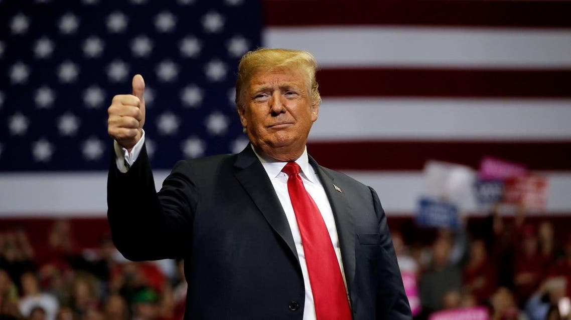 President Donald Trump gestures to supporters during a campaign rally at the Allen County War Memorial Coliseum in Fort Wayne, Indiana, US, on November 5, 2018. (Reuters)