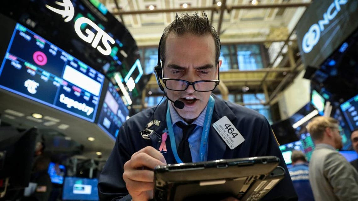 Traders work on the floor of the New York Stock Exchange (NYSE) in New York. (Reuters)