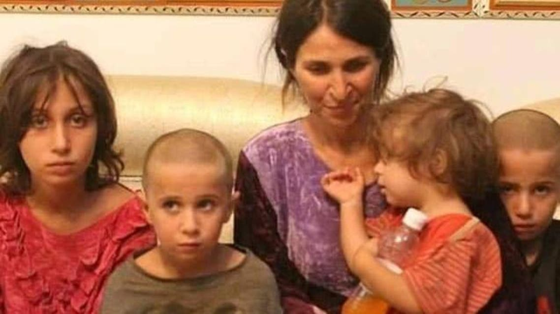One of the kidnapped woman of the Sweida with her children. (Supplied)