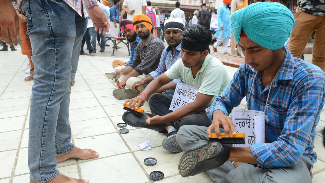 Members of an elementary teachers union polish shoes during a protest against government to demand jobs in Amritsar on August 8, 2018. (AFP)