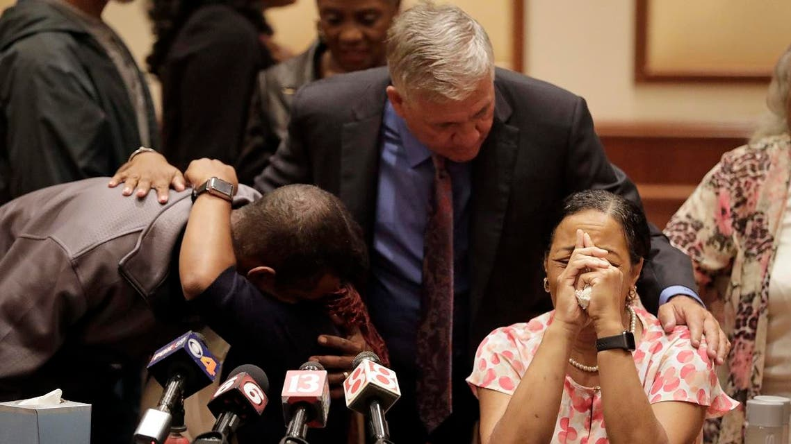 Lisa Berry, right, is comforted by attorney Robert Mongeluzzi while Kyrie Rose is comforted by a family member following a news conference regarding the July 19 duck boat accident, Tuesday, July 31, 2018, in Indianapolis. (AP)