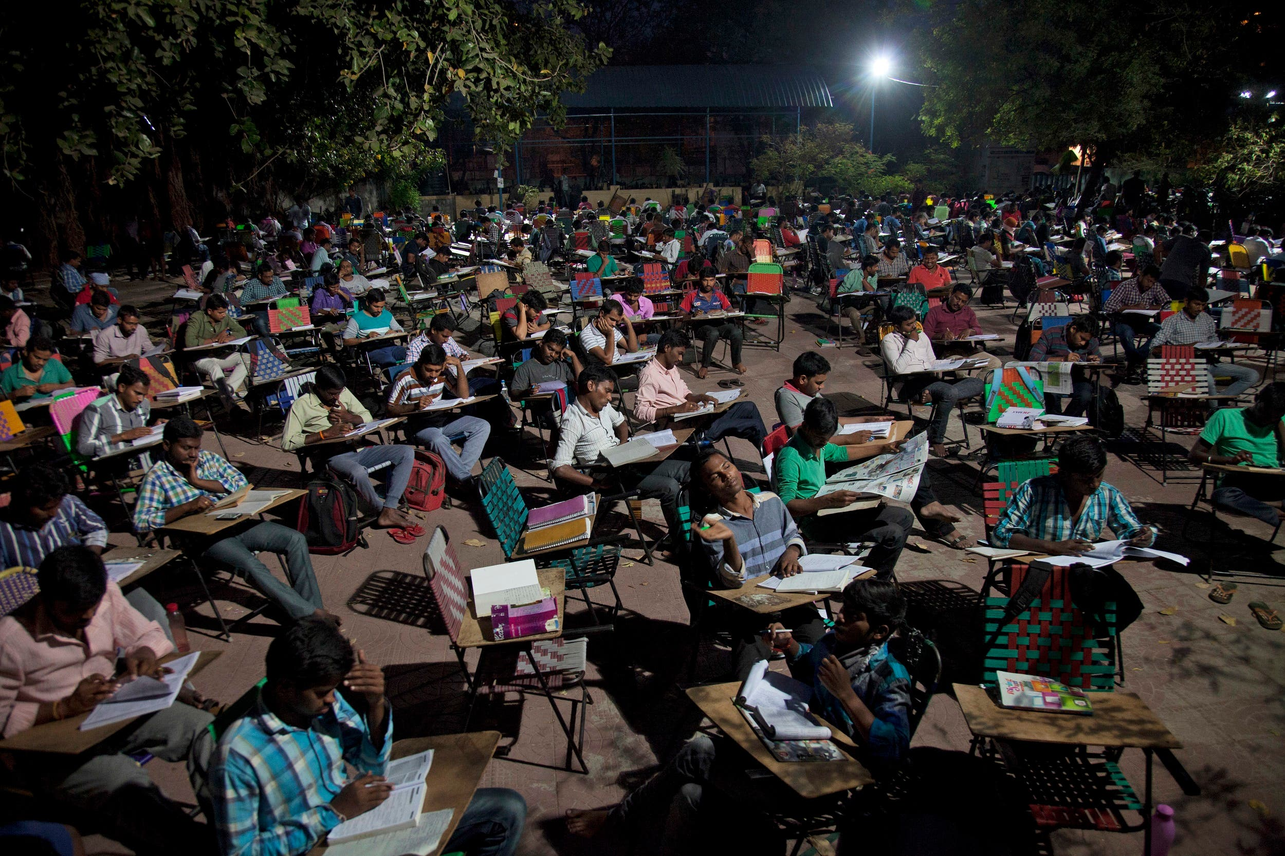 Hundreds of Indian college students and job-seekers study in an open ground in Hyderabad on Feb. 16, 2017. (AP)